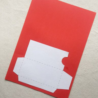 step 1begin by printing out the red envelope template cutting it out and gluing it to the red cover paper